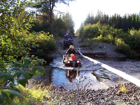 Water crossing at the whitefish river while ATV riding.